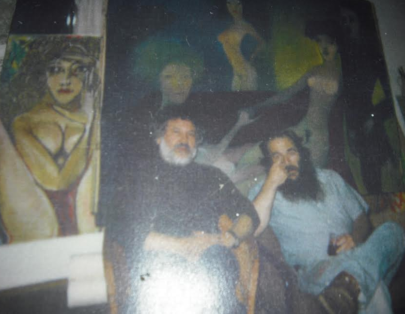 Gongora and Timothy Harney in front of some of Gongora's recent work, likely around '83.